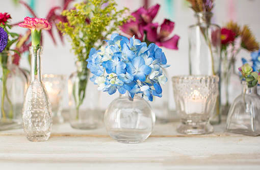 Use patterned and textured glass with our classic bud vases to create a vintage look with a modern air!