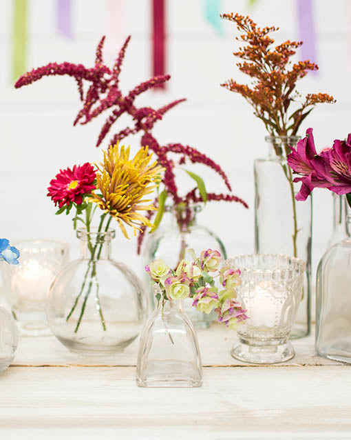 Sprinkle pressed glass heirloom tea light holders throughout your floral display for a simple, clean and timeless look.