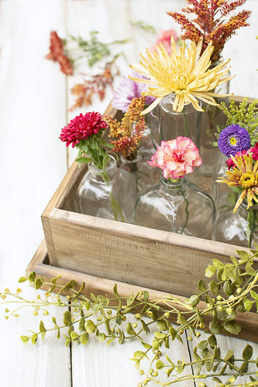 Tuck these petite bottles into our wooden pie box and dress with realistic sprigs and sprays.