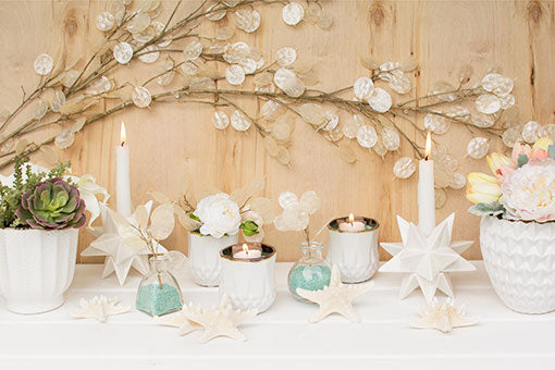 Fill your beach chic wedding with the modern design these starburst candle holders bring! Pair this decoration with bottles of seafoam colored vase filler, starfish, white planter pots and candle holders, and a silver dollar branch.