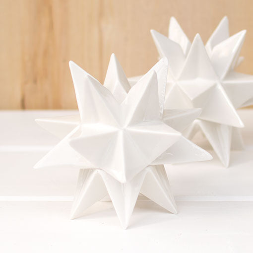 This 4.75 inch tall high quality porcelain decoration has a 1 inch opening to accompany most taper candles.