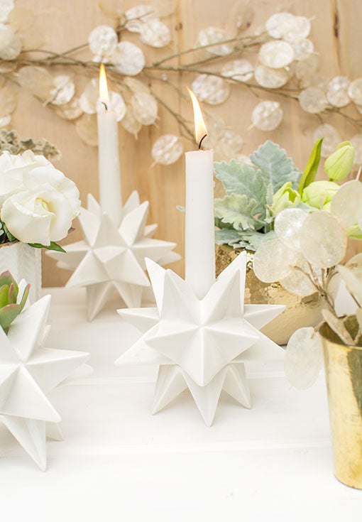 Most taper candles fit into the 1 inch opening of this origami inspired candle holder.