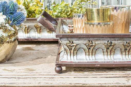 The decorative stamped pattern on each tray complements rustic style and industrial themes.