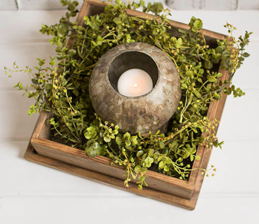 Open the box to display a mercury glass holder with a pillar candle to illuminate the space. Combine with a decorative eucalyptus garland to add natural beauty to the centerpiece.