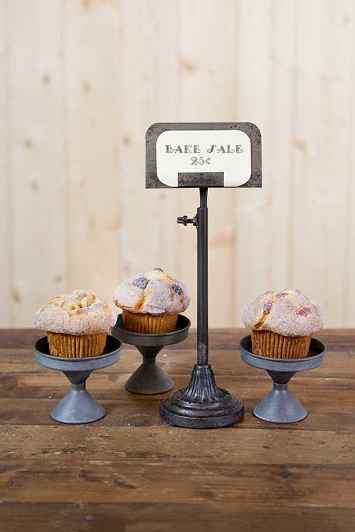 Advertise your bake sale with our metal sign holder and these tin cupcake stands.