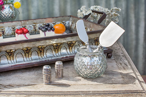 Delight the table with these salt and pepper shakers for your rustic chic event. Add a diamond hobnail holder with cheese knives and a tray with a marble serving tray to this setting for an awe-inspiring look.