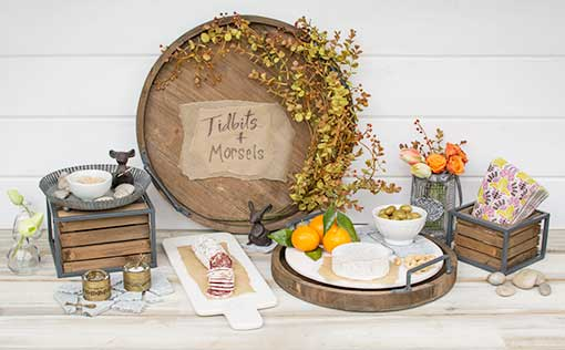 Place the white marble lazy Susan in one of the wood trays for a modern touch to weathered decor. Arrange with our marble cheese tray, realistic eucalyptus spray and cast iron mice to complete your tasting party design.