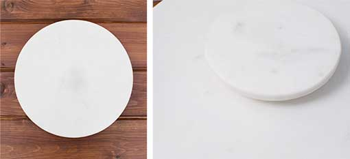 This 12 inch diameter, 1.25 inch tall rotating platform has a sturdy base and easily fits into large round trays or on most table settings.