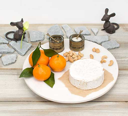 Place the cast iron mice to stand guard over this rotating cheese tray. Add salt and pepper cellars and natural decor such as clementines and slate table scatter to complete the look.