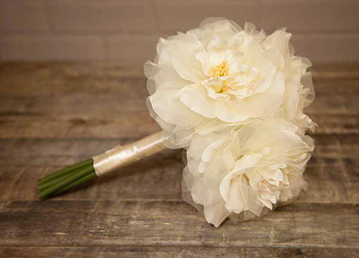 Our 6 stem bouquet is a long lasting sentimental addition to weddings as it stays forever in bloom.