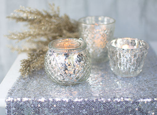 Create an elegant display of glittering decor with our hanging candle holder alongside our geometric and diamond pattered vessels, glitter sprig and sequin table runner.