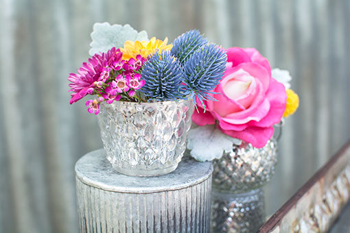 Place this tea light candle holder on top of a corrugated vase with blooming flowers for a one-of-a-kind centerpiece.