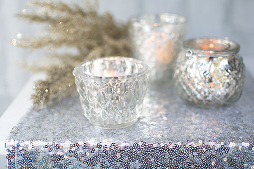 Arrange a sequin table runner with this holder, a glitter sprig and other silver mercury glass candle holders for a sparkling display.