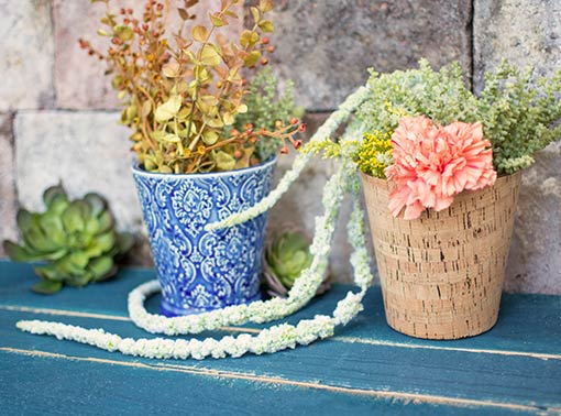 Fill our blue ceramic pots with this rich and colorful sprig. Set it alongside a cork vase with succulents, garden blooms and a cascading amaranthus branch.