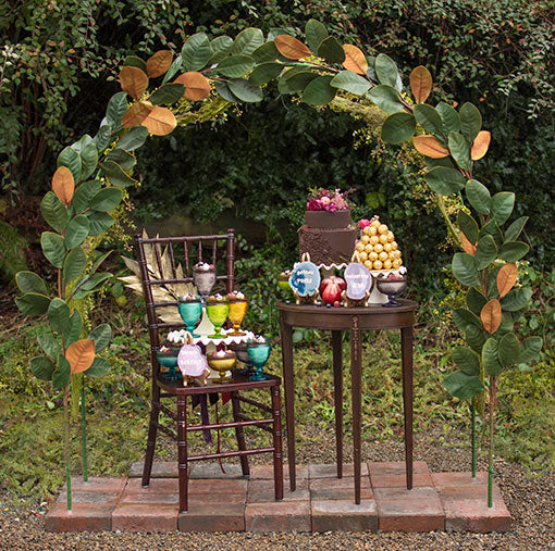 Use floral tape to attach several magnolia sprays to our wedding arch for maximum impact in your displays.