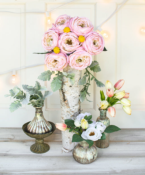 Embellish birch log focal pieces with dusty miller surrounded by seafoam mercury glass and abundant decorative floral!