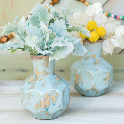For a quick and eye-catching display, use clipped dusty miller sprigs tucked into exotic geometric ceramics.