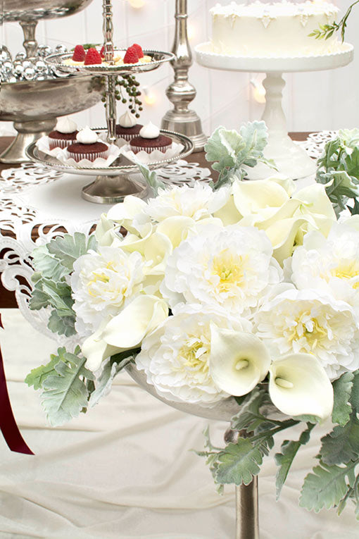 Pair with large white peonies and surround with dusty miller in a striking tall silver compote to up the elegance factor at your events.