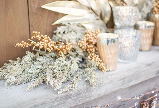 Dress your wedding tables in this glitter stem, our gold toned berry sprig, realistic bay leaf branch, champagne toned candle holders and geometric bud vases.