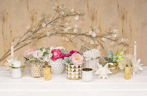 Adorn the walls behind geometric displays with these silver dollar sprays. The gold toned bud vases, hammered planter pots, starburst candle holders and florals lend to the high quality and elevated design of these branches.