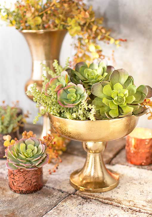 The high quality details of our realistic echeveria and succulent collection complements the rich color of our gold toned compote.