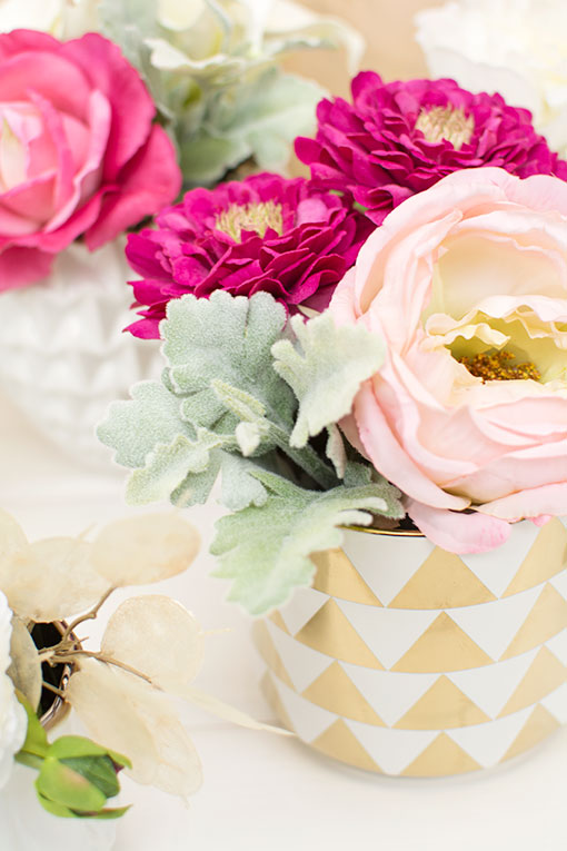 Add our zinnia, rose and dusty miller to a triangle patterned vase for your modern tablescapes.