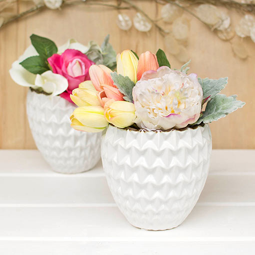 Echo the soft origami folds of our crisp ceramic planters with the ruffled petals of our natural feel peonies.