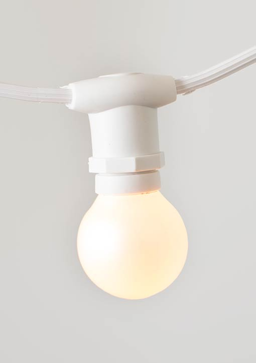 This strand is great for indoor and outdoor installations. Wedding venue owners love white wire globe light; they blend well with tents and fit any wedding theme!