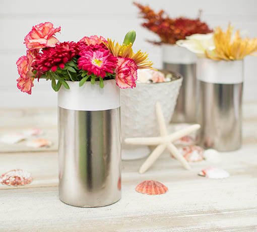 Scatter seashell filler across the table with this vase and our ceramic sea urchin vases for a beach chic centerpiece. Pair with floral bouquets to add pops of color.