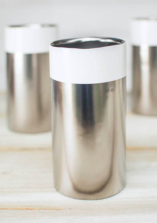 This silver and white ceramic vase has a 2.75 inch opening to easily hold most votive and tea light candles.