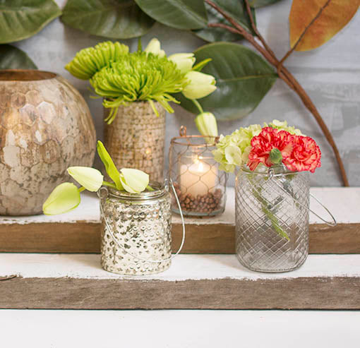 Pair this set with the industrial chic details of our diamond pattern vessel, copper wire holder and mercury glass vases! Add decorative flowers and votive candles to complete the display.