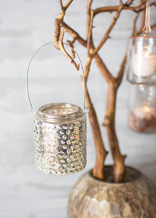 Hang these hobnail vases on a branch with our other votive candle holders for a romantic centerpiece at your wedding.