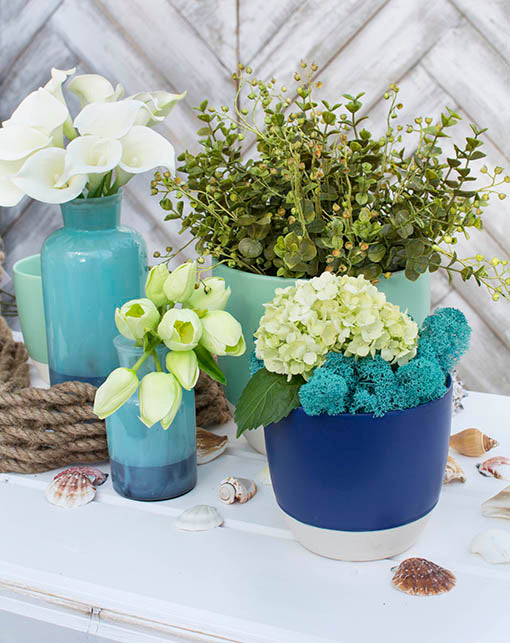 Add our turquoise moss to our nautical themed products for a completed seaside setting.
