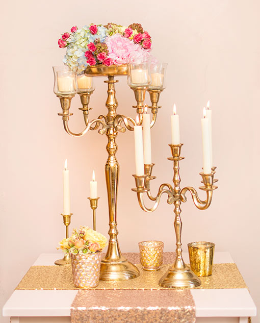 Fit this candelabra with taper candles and pair it alongside our 24 inch candelabra with votive holders and a floral arrangement. Style the scene with mercury glass candle holders and sequin table runners.