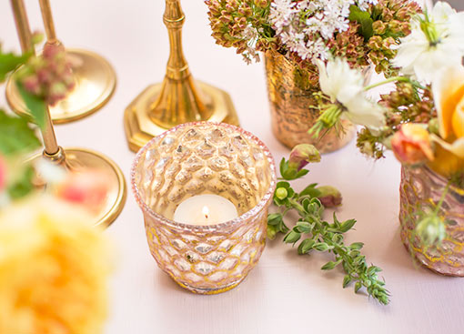 Arrange a votive or tea light candle in this holder for elegant illumination on your wedding tables. Pair it alongside taper candle holders, sprigs and other mercury glass candle holders to complete your centerpiece.