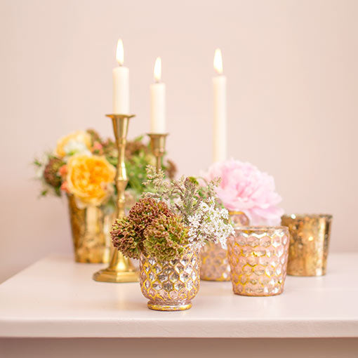 Arrange this set of candle holders with small floral arrangements and our other mercury glass decor. Embellish the scene with candlesticks for a complete look.