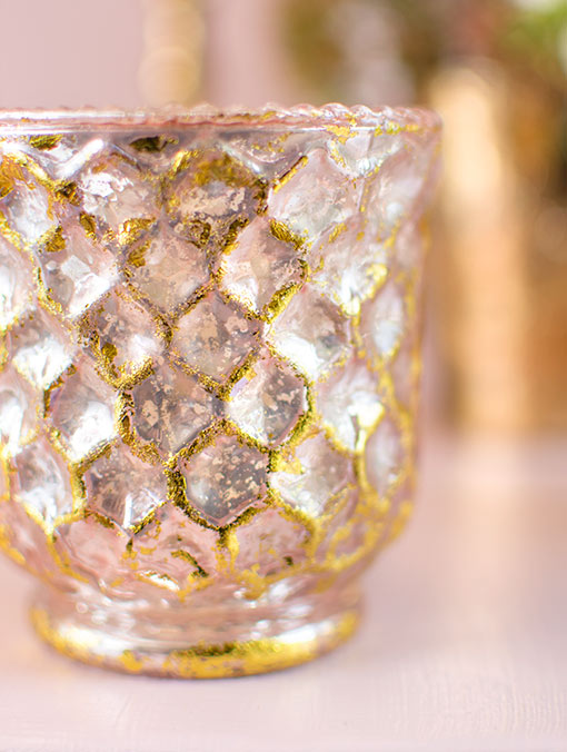 Our set of 6 pink and gold toned mercury glass candle holders inspire unique vintage style in weddings and restaurants with its honeycomb pattern.