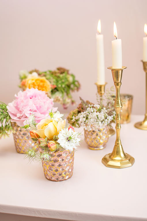 Add your favorite florals to these bud vases and pair them alongside traditional candlesticks and other mercury glass holders for your wedding or restaurant design.