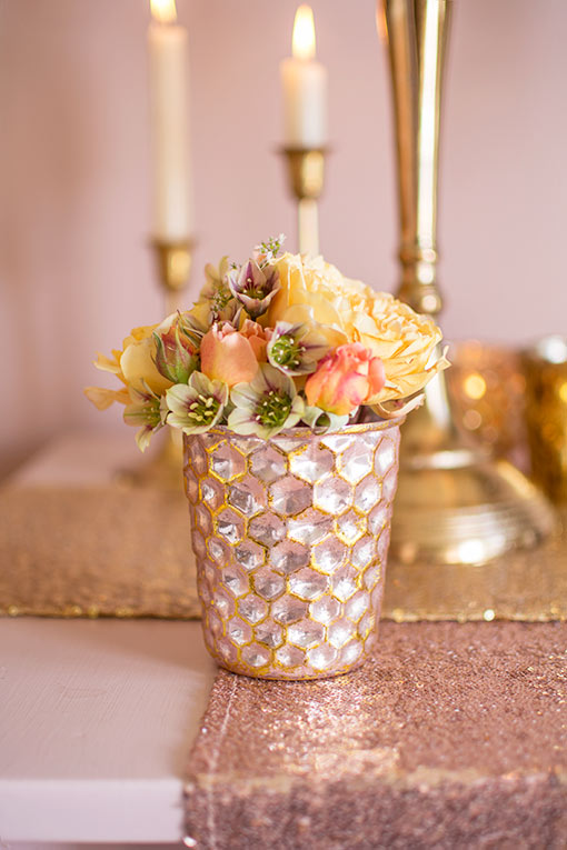 Style this bud vase with a small floral arrangement for your spring wedding centerpieces. Add sequin table runners and candlesticks to complete the scene.