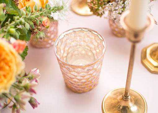 Add a votive candle to each holder for your wedding or restaurant illumination. Complete the style with brass candlesticks, sprigs and other mercury glass decor.