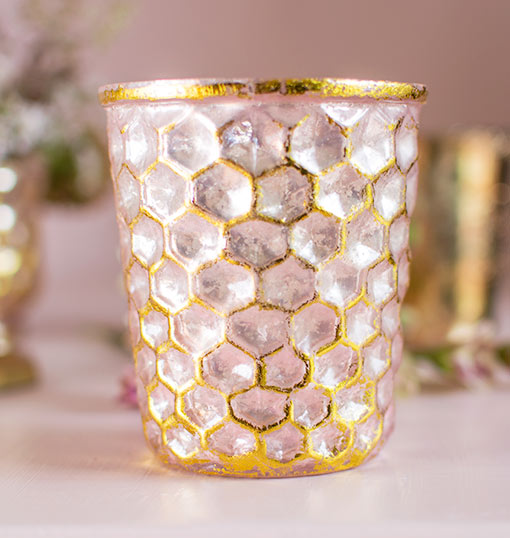 Our set of 6 honeycomb patterned mercury glass candle holders adds delicate vintage details to weddings and bistros with its pink and gold tones.