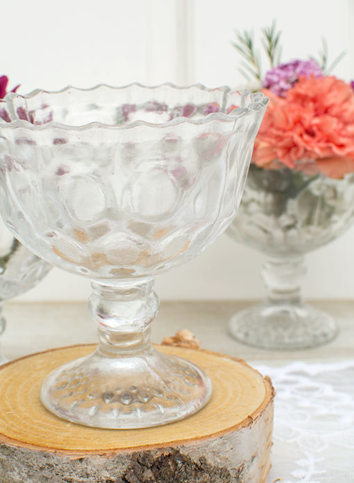 Stand this compote on a mini wood round in your wedding's centerpiece display.