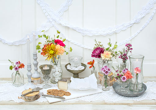 Fill your table with the elegance of our vintage styled vases. Style around it with a lace table runner, marble cheese paddle, tin tart pan, other clear glass vases, candlesticks and floral arrangements.