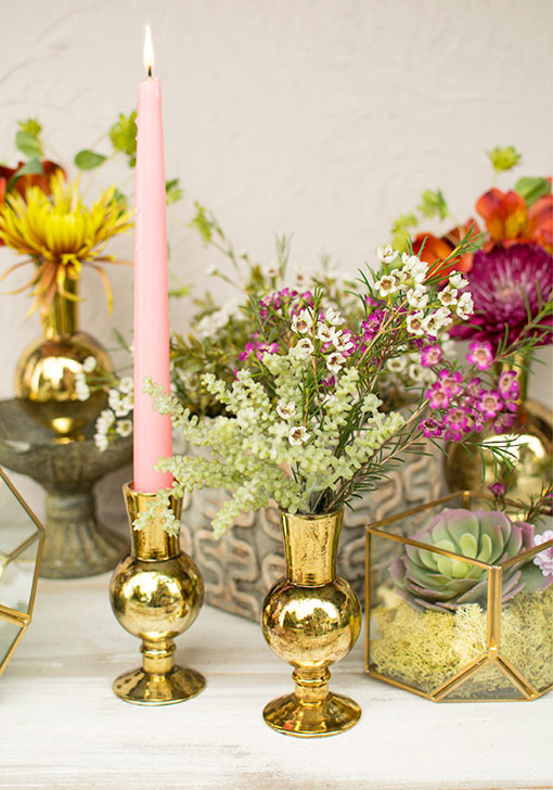 Use this vessel as a bud vase with succulents or as a candle holder for taper candles.