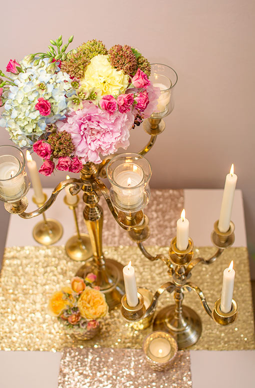 Enchant your wedding with the delicate and traditional design of this candelabra and our 15 inch candelabra. Add a floral arrangement and votive candle holders to this centerpiece along with mercury glass decorations and sequin table runners.
