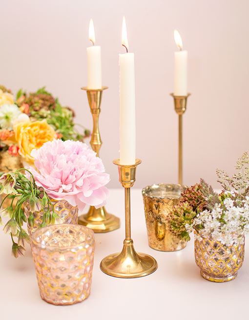 Fill your wedding tables with the romantic design of our brass candlestick alongside honeycomb mercury glass accents.