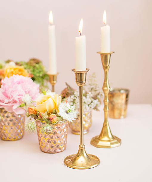 Pair our brass candlesticks with the elegant design of our honeycomb mercury glass bud vases for a romantic summer wedding scene.