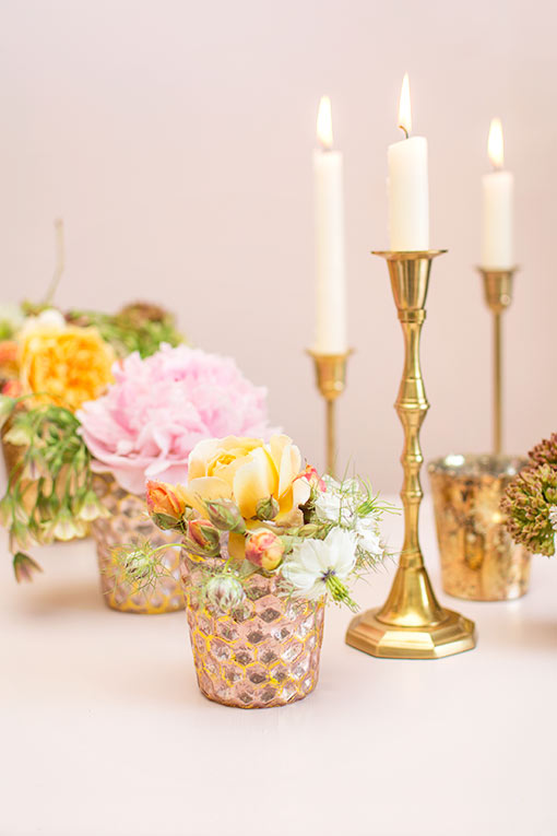 Style this solid brass candlestick with our other candle holders and the elegance of our honeycomb patterned mercury glass bud vases.