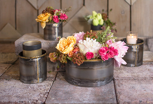 Arrange an elegant floral bouquet in this planter pot for a romantic industrial wedding. Add our other heated patina vases to the scene with black and gold toned candle holders and votive candles to complete the scene.