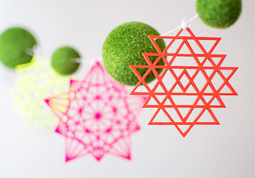 Tie these ornaments on our moss ball garland for a fresh and geometric design at your wedding.